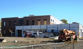 Exterior of RiverMills building with construction vehicles and equipment