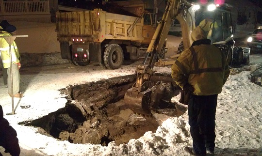 Water Department personnel repairing a water main break during the snow storm of December 17, 2013 on Rolf Avenue