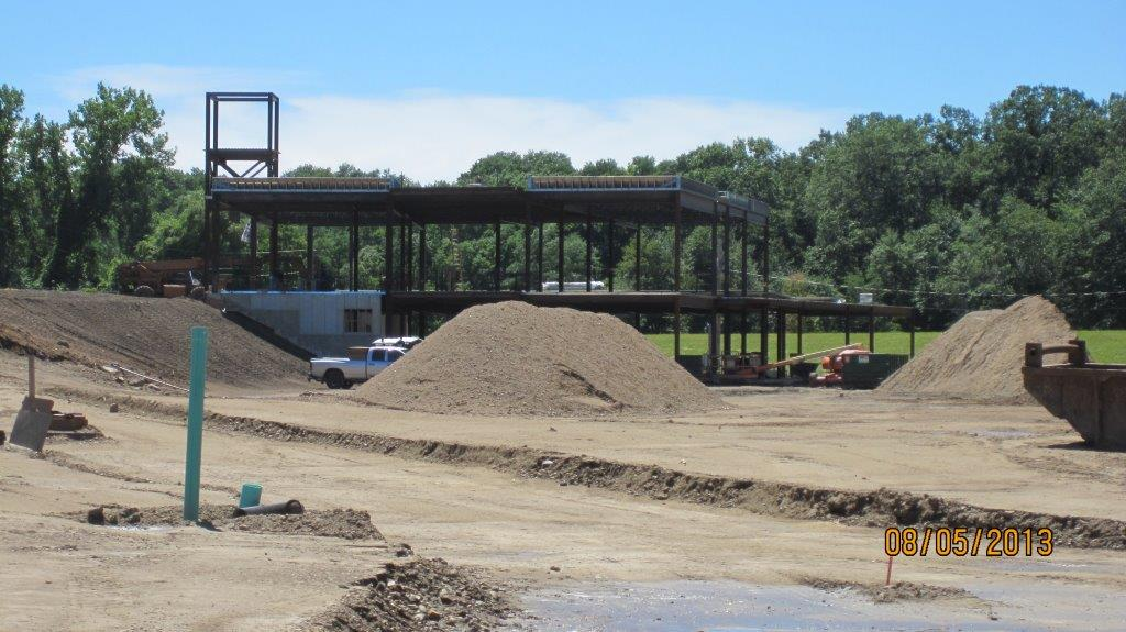 Large piles of gravel at building site