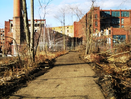 Path leading to old, run-down Uniroyal buildings